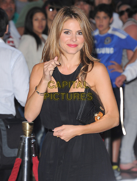 Maria Menounos.The grand opening of luxury Brazilian brand Carmen Steffens' U.S. Flagship store in Hollywood, California, USA..August 2nd, 2012 .half length black dress clutch bag hand arm .CAP/RKE/DVS.©DVS/RockinExposures/Capital Pictures.