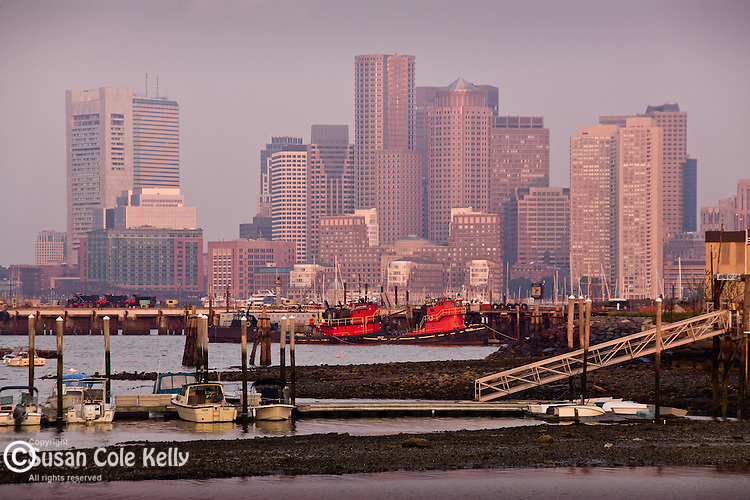 Tugboats frame the Boston Harbor skyline  in Boston, MA, USA