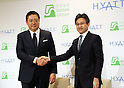 December 1, 2016, Tokyo, Japan - Hirohide Abe (R), Hyatt's Japanese representative shakes hands with Japanese developer Sogo Bussan president Shinya Ozawa as they announce that they will open Hyatt Place brand hotel in Urayasu near Tokyo Disneyland in 2019 at a press conference in Tokyo on Thursday, December 1, 2016. Hyatt Place Tokyo Bay is Japan's first Hyatt Place brand hotel which offers casual and selected services to customers.  (Photo by Yoshio Tsunoda/AFLO) LWX -ytd-