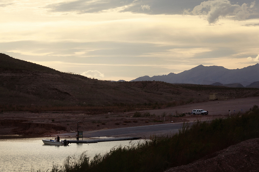CREDIT: Daryl Peveto / LUCEO for The Wall Street Journal.Photo Assignment ID: 11416 Slug: LAKEMEAD ..Lake Mead, Nevada, March 16, 2011 - Boaters launch at Echo Bay on Lake Mead. The boat launch had to be relocarted further down the lake due to drought. ..Lake Mead is the largest water reservoir in the United States. Located on the Colorado River southeast of Las Vegas, it is the major reserve for Nevada, California and Arizona. The city of Las Vegas alone gets 90% of its water from Lake Mead. The lake is currently experiencing a ten year drought, recently dropping to1,083 feet - its lowest level since it was dammed in the 1930s. If it drops further, there is the potential for cutoffs of water for hydro-electricity, agriculture and cities across the Southwest. The current level is near emergency level: if drops to 1075, the Secretary of Interior will have to declare a severe water emergency and major cutbacks will ensue. If gets below 1025, all water for hydro from Hoover Dam shut off. If it falls below 1,000 feet the intake valves that pull water from the Lake for consumption will no longer be operational.
