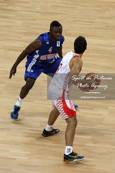 Ogo Adegboye (Great Britain) and Rok Stipcevic (Croatia) in action. Great Britain v Croatia. The London International Basketball Invitational. London Prepares for Olympics 2012. Basketball Arena, Olympic Park. London. 17/08/2011. MANDATORY Credit Sportinpictures/Paul Chesterton - NO UNAUTHORISED USE - 07837 394578.