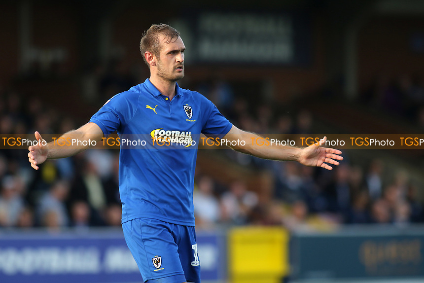 James Hanson of AFC Wimbledon shows his frustration during AFC Wimbledon vs Portsmouth, Sky Bet EFL League 1 Football at the Cherry Red Records Stadium on 13th October 2018