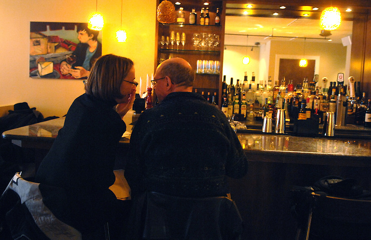 Capitol Hill residents Joan Wright has a word with her husband Bill Vaughan at the bar of Locanda, 633 Pennsylvania Ave., SE.