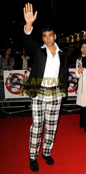 "AKSHAY KUMAR.UK Premiere of ""Chandni Chowk to China"" at the Empire, Leicester Square, London, England, January 12th 2009.full length black jacket white shirt plaid tartan check checked trousers shoes hand waving .CAP/CAN.©Can Nguyen/Capital Pictures"