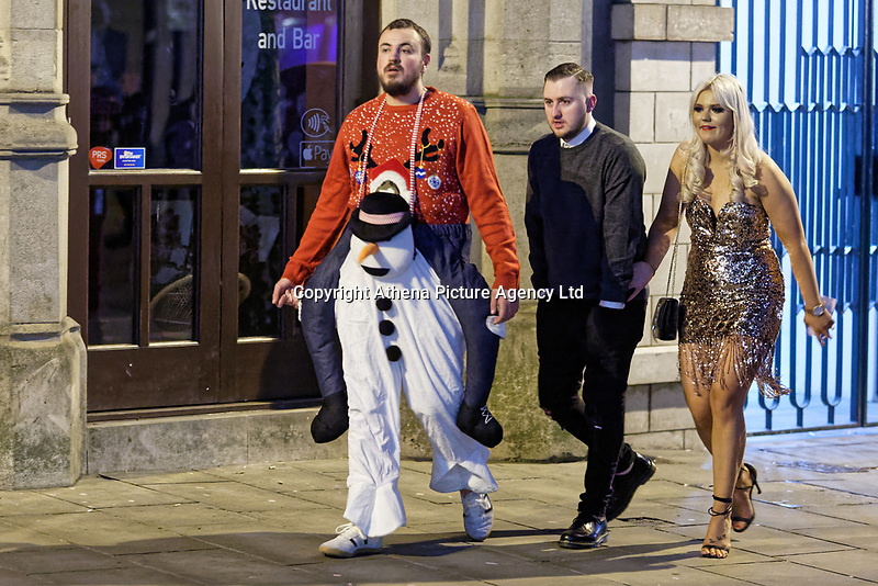 Pictured: A man in a festive costume. Friday 14 December 2018<br /> Re: Revellers in Wind Street, Swansea, Wales, UK.