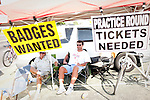 "Nick Pangoulis and Mike Machinsky (left to right), of Florida, sit under a tent along Washington Road selling and buying passes to The Masters Golf Tournament on its first practice day in Augusta, Georgia April 15, 2010. Scalpers must stay 2,500 feet from Augusta National's property line. This was ""the worst Monday yet,"" Pangoulis said of buying and selling tickets for his 15th year."