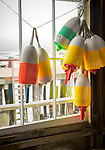 Central coast, Maine: Colorful lobster buoys in a workshed Friendship Harbor