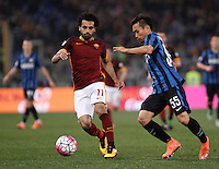 Calcio, Serie A: Roma vs Inter. Roma, stadio Olimpico, 19 marzo 2016.<br /> Roma's Mohamed Salah, left, is challenged by FC Inter's Yuto Nagatomo during the Italian Serie A football match between Roma and FC Inter at Rome's Olympic stadium, 19 March 2016. The game ended 1-1.<br /> UPDATE IMAGES PRESS/Isabella Bonotto