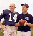 New York Giants Y.A Tittle (14) portrait with unknown coach. Y.A Tittle played for 17 season with 3 different teams. He was a 7-time Pro Bowler and  and was inducted into the Pro Football Hall of Fame in 1971.(SportPics)