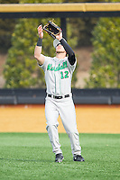 Marshall Thundering Herd right fielder Eric Escobedo (12) tracks a fly ball against the Wake Forest Demon Deacons at Wake Forest Baseball Park on February 17, 2014 in Winston-Salem, North Carolina.  The Demon Deacons defeated the Thundering Herd 4-3.  (Brian Westerholt/Four Seam Images)
