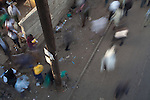 Pedestrians blur by outside Wakulima market in downtown Nairobi.