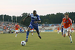 16 August 2014: Edmonton's Tomi Ameobi (ENG) (18) and Carolina's Connor Tobin (20). The Carolina RailHawks played FC Edmonton at WakeMed Stadium in Cary, North Carolina in a 2014 North American Soccer League Fall Season match. Edmonton won the match 3-2.