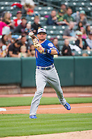 Buck Britton (4) of the Oklahoma City Dodgers throws to first base while on defense against the Salt Lake Bees in Pacific Coast League action at Smith's Ballpark on May 25, 2015 in Salt Lake City, Utah.  (Stephen Smith/Four Seam Images)