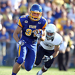 BROOKINGS, SD - AUGUST 31:  Zach Zenner #31 from South Dakota State University breaks loose for a big gain on the opening drive past JoJo Ciancio #21 from Butler in the first quarter Saturday evening at Coughlin Alumni Stadium in Brookings. (Photo by Dave Eggen/Inertia)