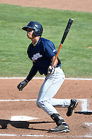 Angel Ortega (10) of the Helena Brewers at bat against the Ogden Raptors at Lindquist Field on July 21, 2013 in Ogden Utah. (Stephen Smith/Four Seam Images)