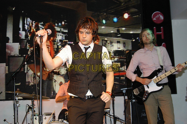 THE KILLERS.Play a live gig and sign copies of their new album,  at HMV Oxford Street, London,.7th June 2004..half length half-length perform music show band .www.capitalpictures.com.sales@capitalpictures.com.©Capital Pictures
