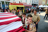 NWA Democrat-Gazette/CHARLIE KAIJO (Foreground) Nicholas Moyes, 16, of Boy Scout Troop 36 helps retire a flag during the First Friday event, Friday, July 6, 2018 at the Downtown Square in Bentonville. <br /><br />The public was invited to attend the American Past Times themed First Friday event which included food trucks, a barbershop quartet, a bike race and a flag retirement ceremony led by area Boy Scout troops.