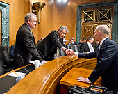 """Richard F. Smith, former Chairman and Chief Executive Officer, Equifax, Inc., right, shakes hands with United States Senator Sherrod Brown (Democrat of Ohio), center, as US Senator Mike Crapo (Republican of Idaho), left, looks on prior to giving testimony before the US Senate Committee on Banking, Housing, and Urban Affairs as they conduct a hearing entitled, """"An Examination of the Equifax Cybersecurity Breach"""" on Capitol Hill in Washington, DC on Tuesday, October 3, 2017. <br /> Credit: Ron Sachs / CNP"""