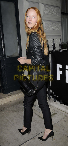 "Morwenna Lytton Cobbold.The ""Firetrap By Sunday Girl"" debut collection launch party, 33 Portland Place, Portland Place, London, England..October 19th, 2011.full length black trousers leather jacket bag purse looking over shoulder .CAP/CAN.©Can Nguyen/Capital Pictures."