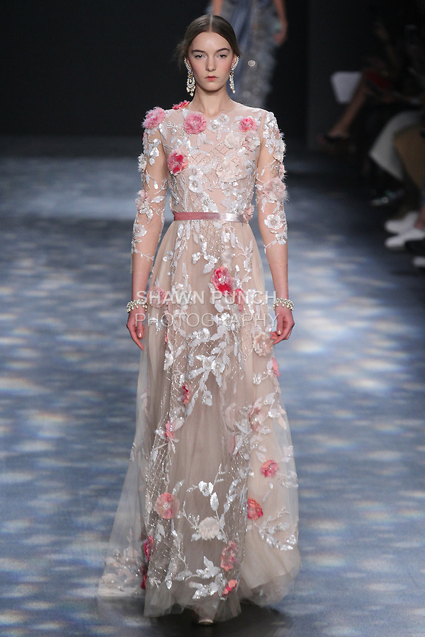 Model Irina walks runway in a nude tulle A-line ball gown with blush 3D feather flower embroidery with touches of fuchsia, from the Marchesa Fall 2016 collection by Georgina Chapman and Keren Craig, presented at NYFW: The Shows Fall 2016, during New York Fashion Week Fall 2016.