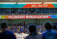 Fans walk out into the grandstand during the ICC Cricket World Cup one day pool match between the New Zealand Black Caps and England at Wellington Regional Stadium, Wellington, New Zealand on Friday, 20 February 2015. Photo: Dave Lintott / lintottphoto.co.nz