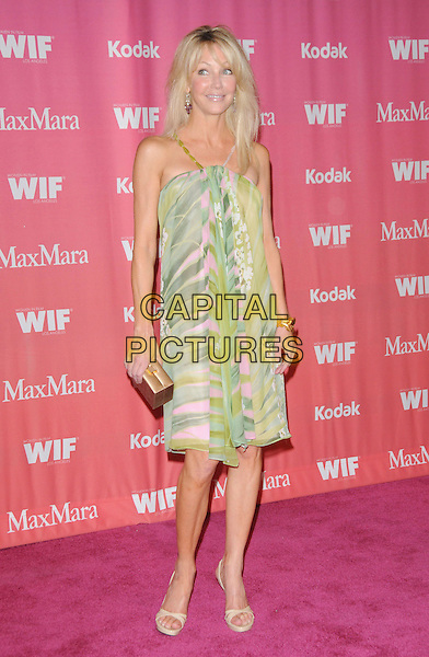 HEATHER LOCKLEAR .at The Women in Film 2009 Crystal .and Lucy Awards held at The Hyatt Regency Century Plaza in Century City, California, USA, June 12th 2009                                                                     .full length dress sandals green pink print straps beads  open toe bow clutch bag .CAP/DVS.©DVS/RockinExposures/Capital Pictures