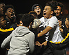Edwin Castellon #4 of Uniondale celebrates with fans who mobbed the field to celebrate the Knights' victory in penalty kicks over Farmingdale in the Nassau County varsity boys soccer Class AA semifinals at Hofstra University on Thursday, Oct. 27, 2017. The game went to the penalty kick portion after a scoreless tie that lasted regulation and two 15-minute overtime periods.