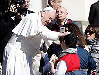 Papa Francesco benedice un fedele al termine dell'udienza generale del mercoledi' in Piazza San Pietro, Citta' del Vaticano, 29 marzo, 2017.<br /> Pope Francis blesses a man at the end of his weekly general audience in St. Peter's Square at the Vatican, on March 29, 2017.<br /> UPDATE IMAGES PRESS/Isabella Bonotto<br /> <br /> STRICTLY ONLY FOR EDITORIAL USE