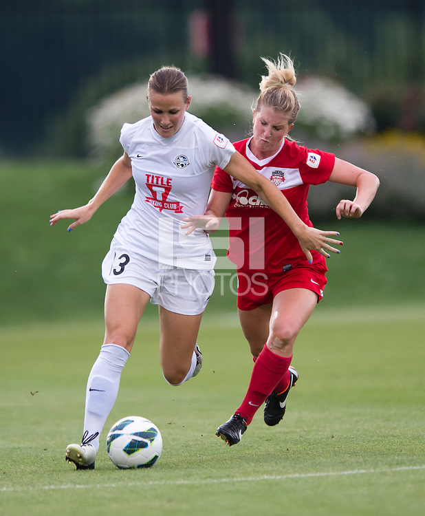 Leigh Ann Robinson (13) of FC Kansas City fights for the ball with Colleen Williams (2) of the Washington Spirit at the Maryland SoccerPlex in Boyds, MD. The Washington Spirit tied FC Kansas City, 1-1.