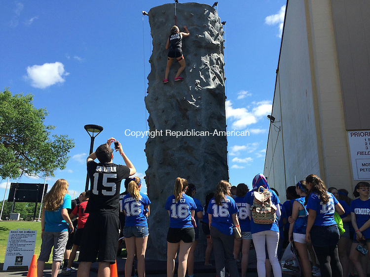 TORRINGTON, CT- 29 May 2015- 052915BJ02-- Senior Taryn Canfield, 17, climbs a rock wall during Raider Rally to at Torrington High School. Canfield raised money from family members and friends to support area non-profits in order to take part in different activities on Friday. Bruno Matarazzo Jr. Republican-American