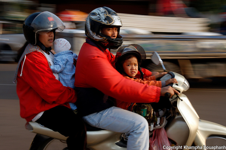 A family travel by scooter on the streets of Vientiane, Laos on Sunday, March 2, 2008.  (Star-Telegram/Khampha Bouaphanh).**NO SALES, NO MAGS**