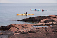 Sea kayakers on Lake Superior in Grand Marais Minnesota.