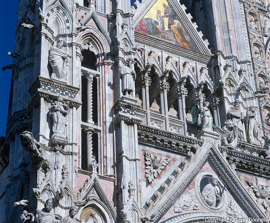 Siena, Tuscany, Italy<br /> Facade detail of Siena's Duomo, an 11th century Gothic style cathedral