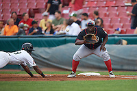 Great Lakes Loons first baseman Justin Chigbogu (29) waits for a pickoff attempt as Chuck Taylor (19) dives back to first during a game against the Kane County Cougars on August 13, 2015 at Fifth Third Bank Ballpark in Geneva, Illinois.  Great Lakes defeated Kane County 7-3.  (Mike Janes/Four Seam Images)