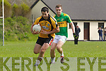 Asdee's Michael Tydings breaks away from Knocknagoshal's John Brosnan last Sunday afternoon in Asdee