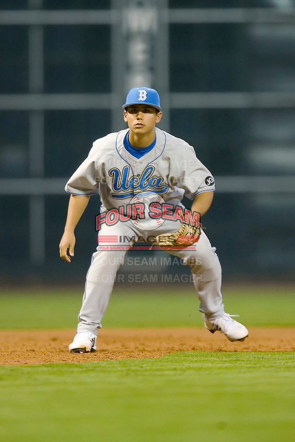 Third baseman Tyler Rahmatulla #5 of the UCLA Bruins on defense versus the Rice Owls in the 2009 Houston College Classic at Minute Maid Park February 27, 2009 in Houston, TX.  The Owls defeated the Bruins 5-4 in 10 innings. (Photo by Brian Westerholt / Four Seam Images)