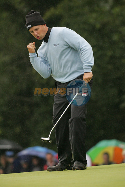 Early leader Niclas Fasth unches the air as he sinks his putt for a birdie on the 9th green during the first round of the Smurfit Kappa European Open at The K Club, Strffan,Co.Kildare, Ireland 5th July 2007 (Photo by Eoin Clarke/NEWSFILE)