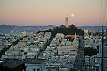 The full Moon rising behind the Coit Tower on Telegraph Hill, San Francisco, California