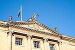 Union Jack flag flying with Britannia holding scales of Justice, top Guildhall building, Bath, Somerset, England, UK