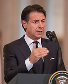 Prime Minister Giuseppe Conte of Italy answers a reporter's question as he and United States President Donald J. Trump hold a joint press conference in the East Room of the White House in Washington, DC on Monday, July 30, 2018.<br /> Credit: Ron Sachs / CNP
