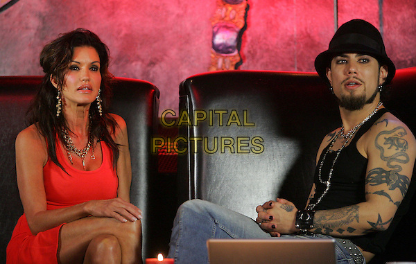 JANICE DICKINSON & DAVE NAVARRO .During episode 2 of Dave Navarro's weekly internet TV show, Spread Entertainment on Maniatv.com featuring Janice Dickinson held at The Dragonfly in Hollywood, California, USA..half 3/4 length sitting red dress legs crossed jeans denim black top tattoos hat goatee facial hair  .May 24th, 2007.CAP/DVS.©Debbie VanStory/Capital Pictures