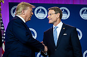 United States President Donald J. Trump is greeted by Tony Perkins, President, Family Research Council, before delivering remarks at Values Voter Summit at the Omni Shoreham Hotel on October 12, 2019 in Washington, DC. The appearance at the Summit comes as evangelical leaders this week criticized Trump's decision to stand down US forces in northern Syria.  <br /> Credit: Pete Marovich / Pool via CNP