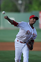 Relief pitcher Yunior Ortega (20) of the Greenville Drive in a game against the Delmarva Shorebirds on Monday, April 29, 2013, at Fluor Field at the West End in Greenville, South Carolina. Delmarva won, 6-5 in game one of a doubleheader. (Tom Priddy/Four Seam Images)