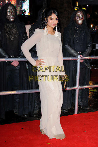 """AFSHAN AZAD.""""Harry Potter And The Deathly Hallows: Part 1"""" World Film Premiere, Empire cinema Leicester Square and Odeon Leicester Square, London, England, UK, 11th November 2010..full length cream long sleeve maxi dress hand on hip beige .CAP/CJ.©Chris Joseph/Capital Pictures."""