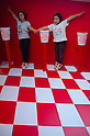 """September 17, 2011 : Yokohama, Japan - A mother and a daughter visit an optical illusion installation during the grand opening of the Nissin Cup Noodles Museum. Visitors can learn about the history of the Cup Noodles product and partake in a session to make their own homemade instant ramen noodles at the museum's """"Chikin Noodle Factory"""". The museum's art director, Kashiwa Sato, is also in charge of graphic design for the massive Japanese clothes retailer Uniqlo. (Photo by Yumeto Yamazaki/AFLO)"""