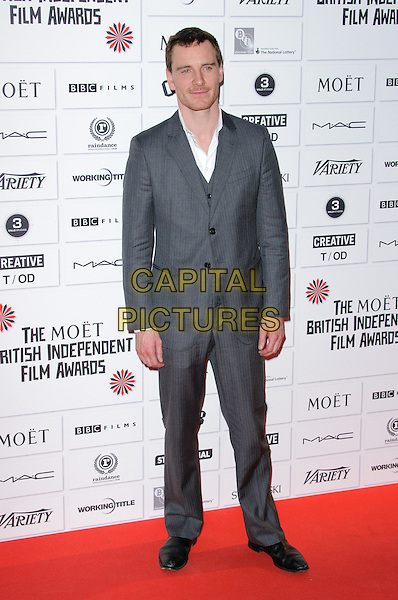 Michael Fassbender.14th Moet British Independent Film Awards 2011, Old Billingsgate, Lower Thames Street, London, England, 4th December 2011.full length grey gray pinstripe white shirt stubble facial hair suit.CAP/CJ.©Chris Joseph/Capital Pictures.