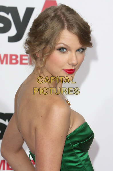 "TAYLOR SWIFT.""Easy A"" Los Angeles Premiere held at Grauman's Chinese Theatre, Hollywood, CA, USA..September 13th, 2010.headshot portrait strapless gold necklace hair up red lipstick green strapless half length looking over shoulder .CAP/ADM/CH.©Charles Harris/AdMedia/Capital Pictures"
