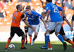 Dundee United v St Johnstone.....21.02.15<br /> David Wotherspoon weaving run on goal is ended by Sean Dillon<br /> Picture by Graeme Hart.<br /> Copyright Perthshire Picture Agency<br /> Tel: 01738 623350  Mobile: 07990 594431