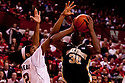 30 November 2011: Travis McKie #30 of the Wake Forest Demon Deacons drives into David Rivers #2 of the Nebraska Cornhuskers during the first half at the Devaney Sports Center in Lincoln, Nebraska. Wake Forest defeated Nebraska 55 to 53.