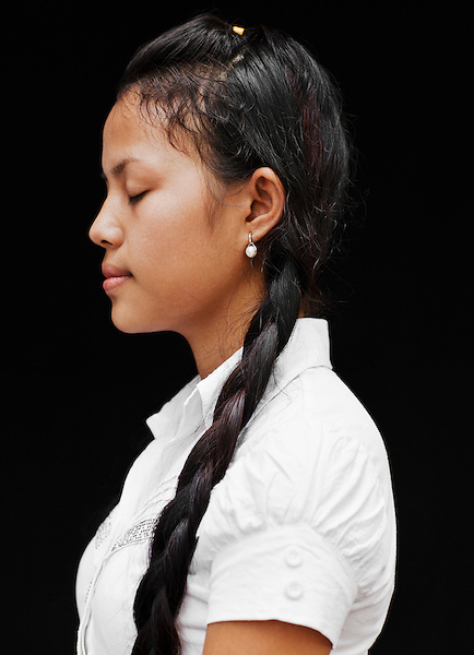 Portrait of Smot singer Srey Pov. Srey is a student and performer with Cambodia Living Arts in Phnom Pehn, Cambodia...Smot Chanting is a  complex and demanding way of melodically reciting Khmer and Pali literature, and is an integral form of singing unique to Khmer mourning.. .Cambodian Living Arts works to support the revival of traditional Khmer performing arts and to inspire contemporary artistic expression. CLA supports arts education, mentorship, networking opportunities, education, career development, and income generating projects for master performing artists who survived the Khmer Rouge as well as the  next generation of student artists.
